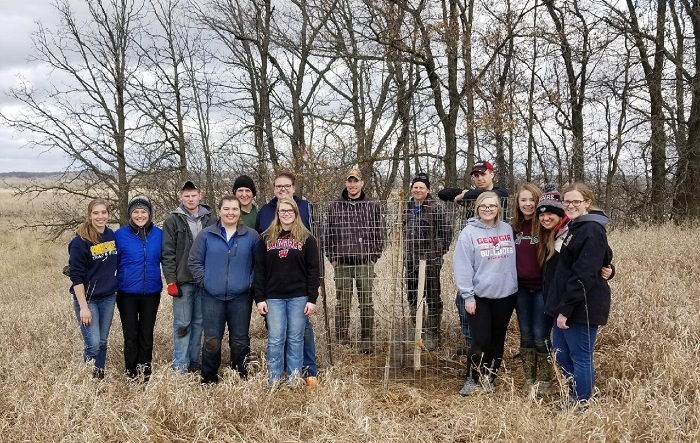 In early April, members of several partner organizations assisted Department of Natural Resources staff to establish five small apple and crabapple tree plots, totaling 85 trees. - Photo credit: DNR