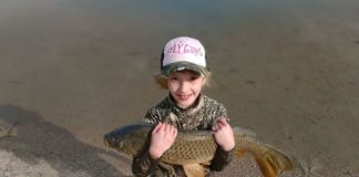Young Girl Catches First Carp