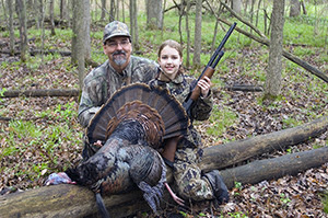 Joe Robison and his daughter, Sidney pose with Sidney's spring turkey. Hunters in Michigan have opportunities to shoot turkeys in the spring and fall.