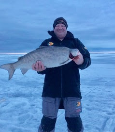 Oklahoma Native Billy King holding his Minnesota State Record Whitefish caught during his first ever Ice fishing trip.