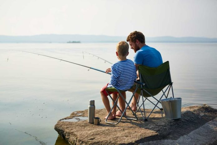 Father and Son Enjoying a Day of Fall Fishing Together | Outdoor Newspaper