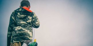 Boy carrying duck hunting decoys | Outdoor Newspaper