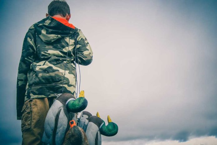 Boy carrying duck hunting decoys   Outdoor Newspaper