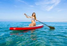 Woman Practicing Paddle - Outdoor Newspaper